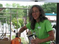 Local Walldog Lead, Carole Bersin, mixes paint