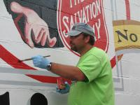 Finishing touches at the Salvation Army by artist Dave Petri