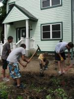 Volunteers building a rain garden at a different CLCLT house in Kingfield about 10 years ago.